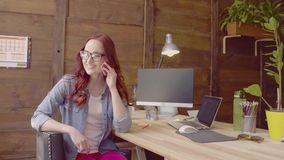 Freelancer beautiful woman in glasse having phone conversation. stock video footage