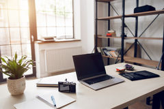 Freelancer desktop with necessary work tools Royalty Free Stock Image