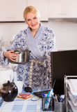 Freelancer with dishware working on PC Royalty Free Stock Photo