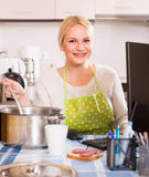 Freelancer with dishware working on PC Royalty Free Stock Photos