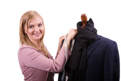 Freelancer - Fashion designer or Tailor working on a design or draft, she takes measure on a dressmakers dummy Stock Images