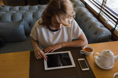 Freelancer girl working on digital tablet with blank copy space screen Stock Photography