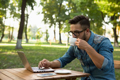 Freelancer hipster man drinking coffee Stock Photography
