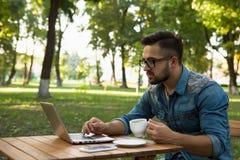 Freelancer hipster man working Stock Photo