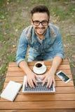 Freelancer hipster man working Royalty Free Stock Image