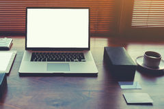 Freelancer needs mock up on wooden table in home interior, laptop computer Royalty Free Stock Photography