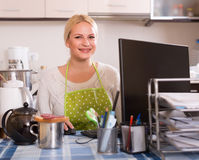 Freelancer with PC, tea and sandwich Royalty Free Stock Photo
