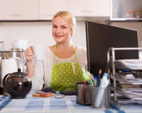 Freelancer with PC, tea and sandwich Stock Image