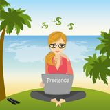 Freelancer sitting on the beach in lotus pose and works Stock Photography