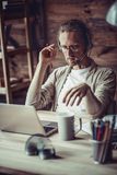 Freelancer using handsfree headset to work online. Man with headphones discussing business project Stock Images