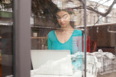 Freelancer is in window Royalty Free Stock Photo
