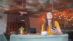 Freelancer woman enjoying cofee or cocoa while working in cafe.  stock footage