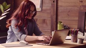 Freelancer woman sitting at chair, streching, typing, making phone call. stock footage