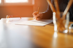 Freelancer woman working with documents. Royalty Free Stock Photos