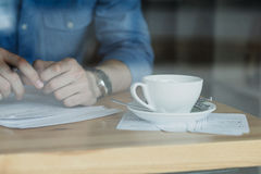 Freelancer working in coffee shop. Stock image Stock Photo