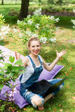 Freelancer working in the garden. Writing, surfing in the internet. Young woman relaxing and having fun in park area. Distance edu. Cation, freelance concept Stock Photos