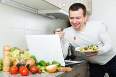 Freelancer working and holding vegies Royalty Free Stock Image
