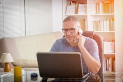 Freelancer working at home Royalty Free Stock Photography