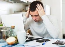Freelancer working with laptop. Male freelancer working with laptop from home Royalty Free Stock Image