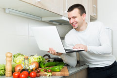 Freelancer working with laptop. Satisfied male freelancer working with laptop from home Stock Photos