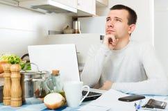 Freelancer working with laptop Royalty Free Stock Image