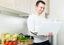 Freelancer working with laptop Royalty Free Stock Photos