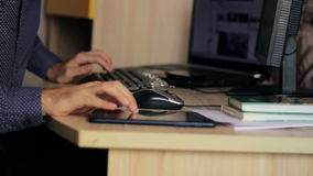 Freelancer working with  a laptop and a tablet at stock video footage