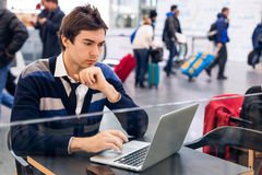 Freelancer working with a laptop in train station royalty free stock photos