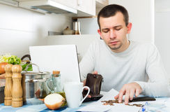 Freelancer working with laptop. Upset male freelancer working with laptop from home Stock Photography