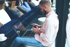 Freelancer working on-line at hipster loft space Royalty Free Stock Photography