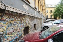 Cars in mosaic parking. Freely accessible for examination of the exposition of mosaic art in the courtyard of residential buildings Royalty Free Stock Images