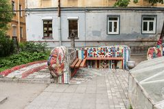 Mosaic bench in the yard. Freely accessible for examination of the exposition of mosaic art in the courtyard of residential buildings Royalty Free Stock Photos