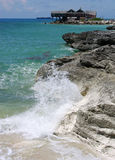 Freeport Coast. The eroded coast of Freeport with house in a background destroyed by the hurricane on Grand Bahama Island, The Bahamas Royalty Free Stock Photo