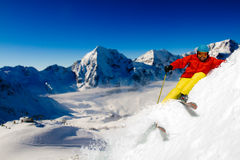 Freeride. In fresh powder snow - man skiing downhil Stock Images