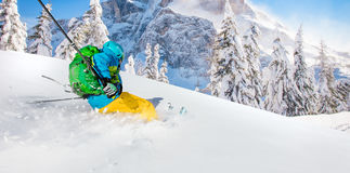 Freeride in fresh powder snow. Freeride in fresh powder snow during sunny day Stock Image