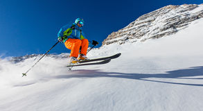 Freeride in fresh powder snow. Freeride in fresh powder snow during sunny day Royalty Free Stock Photo
