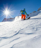 Freeride in fresh powder snow. Freeride in fresh powder snow during sunny day Royalty Free Stock Images
