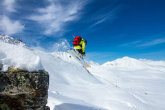 Freeride on  Kamchatka. Freerider jumping from the hill in Kamchatka mountains Stock Photos