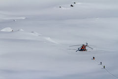 Freeride on  Kamchatka. The helicopter on the snow of Kamchatka mountains Royalty Free Stock Images