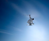 Freeride skier. Jumping high in the blue sky Royalty Free Stock Photography