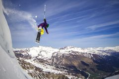 Freeride skier jumping of the cliff stock photos
