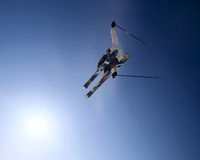 Freeride skier. Jumping high in the blue sky Royalty Free Stock Image