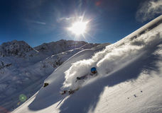 Freeride Skier. A freeride skier make a turn in powder snow on a sunny day in western Austria Stock Image
