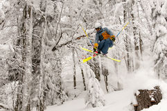 Freeride Skier. Moving down and jumping in powder snow Stock Photos