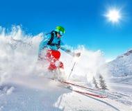 Freeride skier on piste running downhill Stock Photography