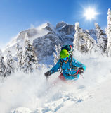 Freeride skier on piste running downhill Royalty Free Stock Photography