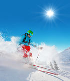 Freeride skier on piste running downhill Stock Photos