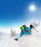 Freeride skier on piste running downhill Stock Photo
