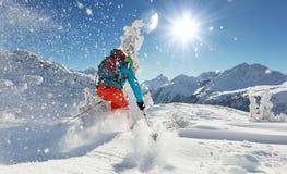 Freeride skier on piste running downhill Royalty Free Stock Photo