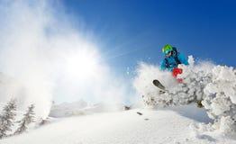 Freeride skier on piste running downhill Stock Images